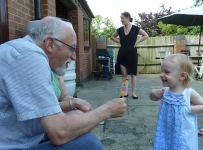 Grandpa and Annabelle share an ice lolly